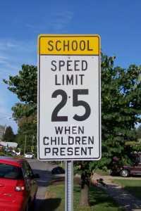 School speed limit sign by Monroe School