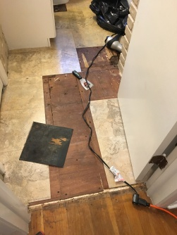 "Removing vinyl to reveal 1/4"" plywood over original floor"