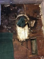Plywood cut around toilet